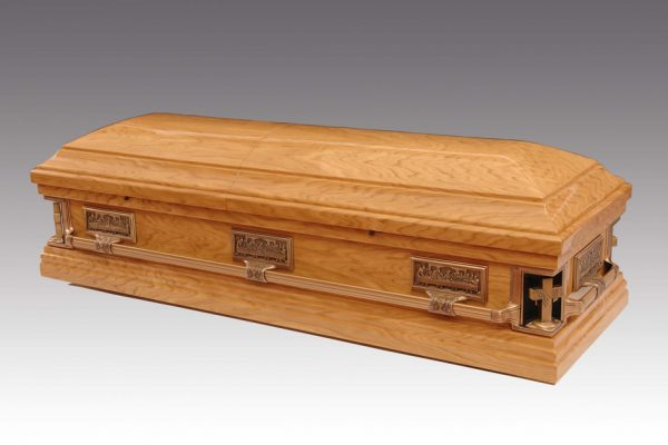 The Last Supper Casket - Solid Oak Casket with classic domed lid, featuring the last supper images. Finished in a high gloss lustre and fitted with fixed metal bar handles and a premium quality interior.  Additional charges may be occurred at certain cemeteries to accommodate caskets and oversized coffins. Your arranger can advise you on these costs.