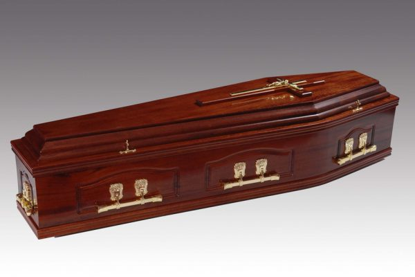 Panelled solid mahogany coffin, finished in a high gloss and fitted with brass finished metal handles and a superior interior.