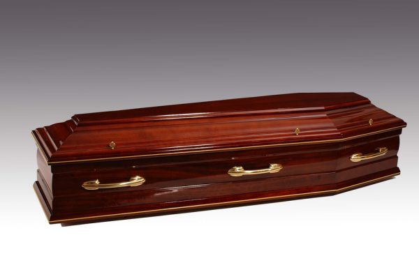 Crafted from the finest solid mahogany, embellished with brass trimming and finished in a 'piano' high gloss fitted with solid brass handles and a premium quality interior.  Additional charges may be occurred at certain cemeteries to accommodate caskets and oversized coffins. Your arranger can advise you on these costs.