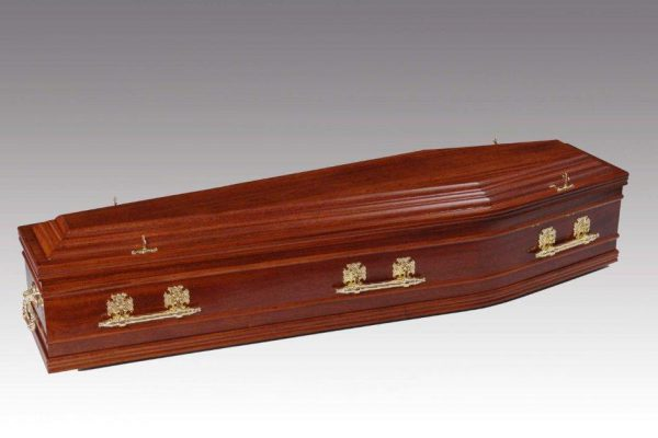 Mahogany veneered coffin with profiled features to coffin sides, fitted with metal handles and a standard interior.