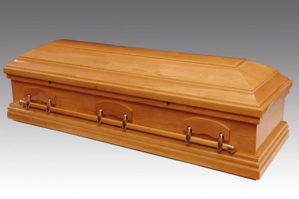 Solid Oak Casket with classic domed lid. Finished in a high gloss lustre and fitted with fixed metal bar handles and a premium quality interior.  Additional charges may be occurred at certain cemeteries to accommodate caskets and oversized coffins. Your arranger can advise you on these costs.