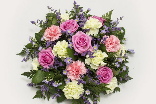 A classic posy arrangement of Carnations, Roses, September Flowers, Sea Lavender (Limonium) and greenery. From €60.