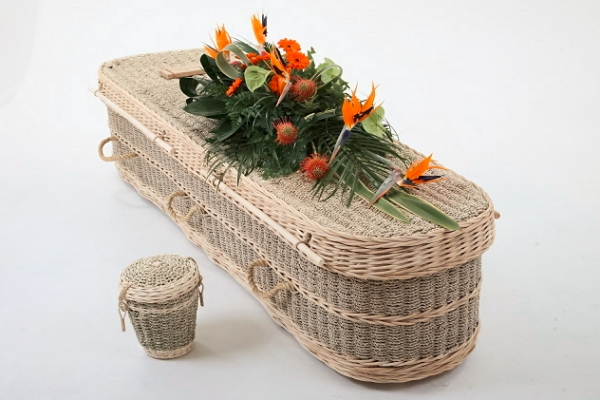 Seagrass Coffin - Seagrass is renowned for its quality and durability, which makes it an ideal material for woven products.  The seagrass used for this coffin is grown in paddy fields.  At a certain point during the growing season, the fields are flooded with sea water, hence the name seagrass.   A sustainably produced white lining with lace trim interior linen lining is available.