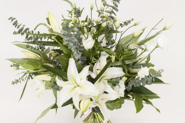 A simple yet elegant hand-tied arrangement of Lilies, Lisianthus, Veronica and greenery. From €60.