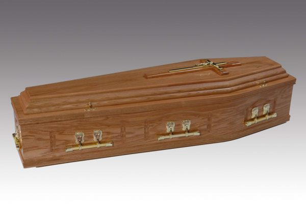 Panelled solid oak coffin, finished in a high gloss and fitted with woodbar metal handles and a superior interior.
