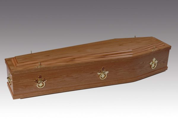 """The """"Chester"""" American Oak Coffin is fitted with brass ring mountings and a satin-lined interior."""