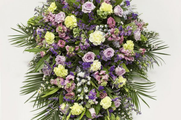 Bells of Ireland, Carnations and Blue Status combined with fresh greenery. A predominantly pink and blue arrangement of Delphiniums, September Flowers, Roses - from €175.