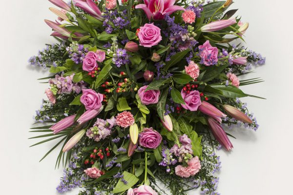 A beautiful arrangement of Lilies, Roses, September Flowers, Hypericum Berries, Stocks, Lisianthus and fresh greenery. From €175.