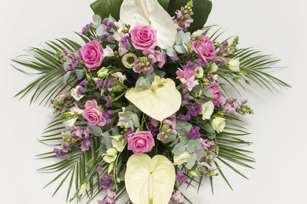 A combination of Anthuriums, Roses, Lisianthus, Stocks and greenery. From €160.