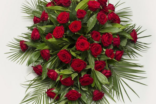 A classic combination of Red Roses and carefully selected greenery. From €220.