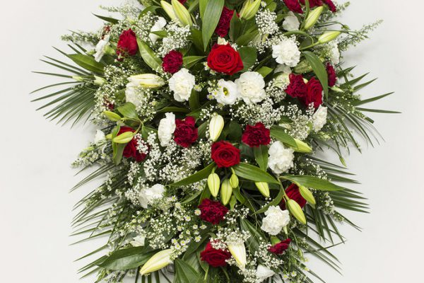 An elegant arrangement of Lilies, Roses, September Flowers, Carnations, Lisianthus, Gypsophila and greenery. From €180.