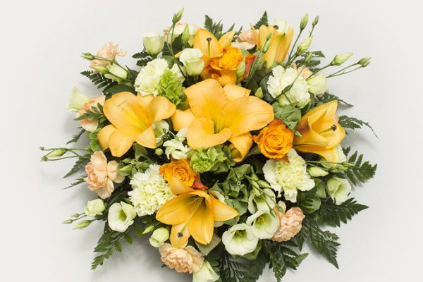 A vibrant arrangement of Lilies, Lisianthus, Bells of Ireland and Carnations, combined with greenery. From €60.